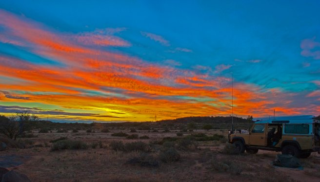 SUNSET NEAR TIBOOBURRA IN FAR WEST NEW SOUTH WALES.
