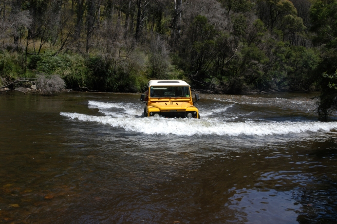 MY MATE IN THE 'YELLOW PERIL' HAVING SOME WADING PRACTISE.
