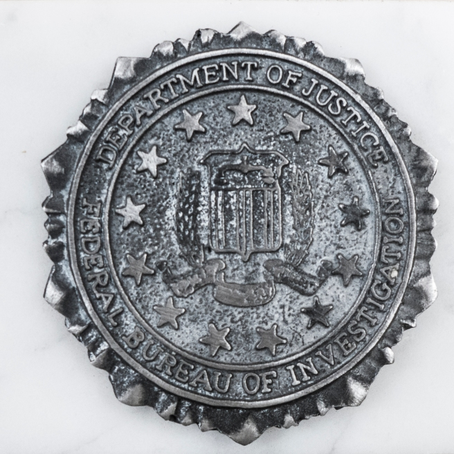 THE EMBLEM OF THE FBI COLLEGE QUANTICO